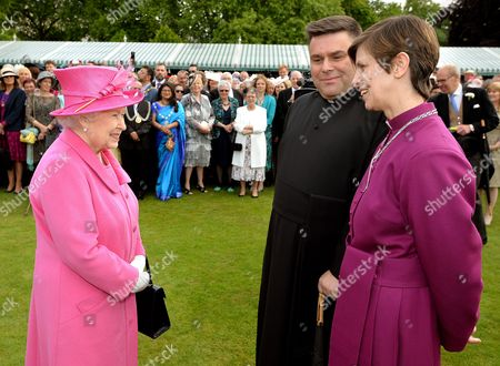 Queen Elizabeth II talks with the Bishop of Stockport Rev Libby Lane and her husband Rev George Lane