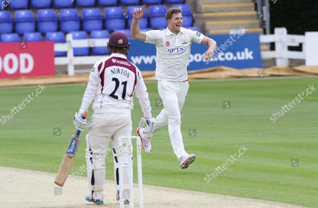 Craig Meschede of Glamorgan celebrates after taking the wicket of Robert Newton of Northants