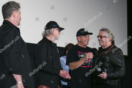 Stock Image of George Miller shakes hands with the stuntman Dale Bench and Vincent Gil