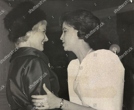 Mme. Anita Guerrero Wife Of Leon Guerrero Philippine Ambassador To Britain (r) Meeting Actress Ann Todd At Reception At Philippine Embassy. Box 0571 210515 00255a.jpg.