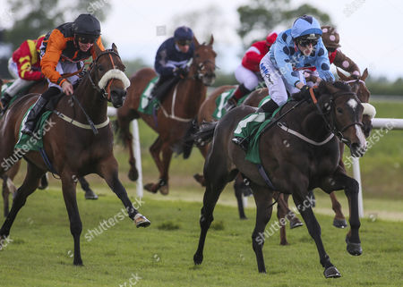 Stock Image of EXCLUSIVE CONTRACT and Jacob Butterfield Win the Bill Curbishley 70th Celebration Fillies´ Handicap for trainer Ollie Pears Thirsk Racecourse