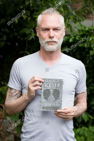 Stock Picture of Jonathan Kemp with his book