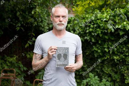 Jonathan Kemp with his book