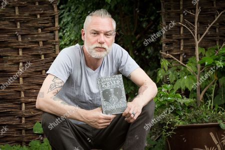 Stock Photo of Jonathan Kemp with his book