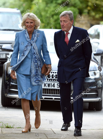 Camilla Duchess of Cornwall (left) is met by the Lord-Lieutenant of Oxfordshire Sir Tim Stevenson as she arrives at St Martin's Church, Bladon, to unveil a stain glassed window to commemorate the 50th Anniversary of Sir Winston Churchill's death
