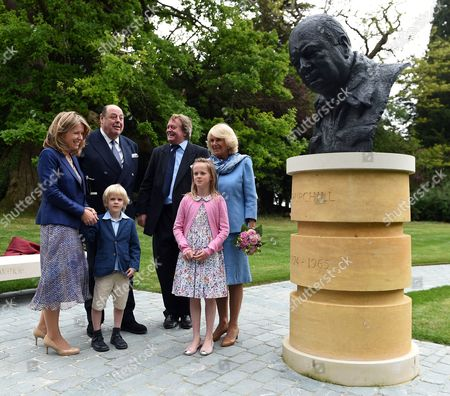 Camilla Duchess of Cornwall (right) with Sir Nicholas Soames MP (second left) along with The Duke of Marlborough, The Duke of Marlborough (third right) his wife Edla Griffiths (left), his son Lord Caspar Spencer-Churchill (third left) and daughter Lady Araminta Spencer-Churchill stand next to a newly unveiled bust of Sir Winston Churchill in the grounds of Blenheim Palace