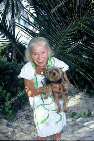 Madame Carven at home with her dog, Antilles, Guadaloupe, France