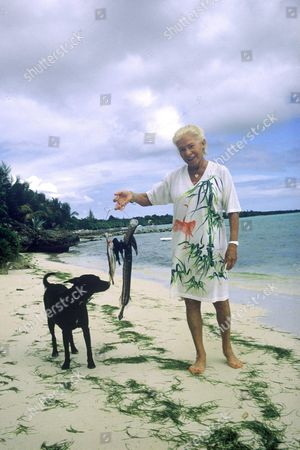 Madame Carven with her dog, Antilles, Guadaloupe, France