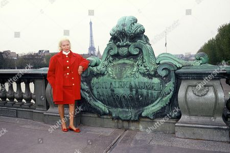 Madame Carven poses in front of Eiffel Tower, on Alexander Bridge, Paris, France