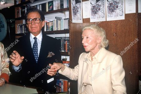 Madame Carven with Jean Barthet during the signing of her book at Brentanos, Paris, France