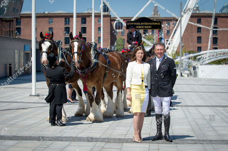 Stock Picture of Olympic Gold Medalist Peter Charles and show president Nina Barbour pose with the Waldburg Shire Team in front of the Echo Arena, Liverpool at the launch of the inaugural Liverpool International Horse Show to take place 1-3 January 2016