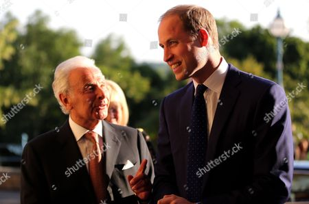 Prince William is greeted by Lord Levy (left)