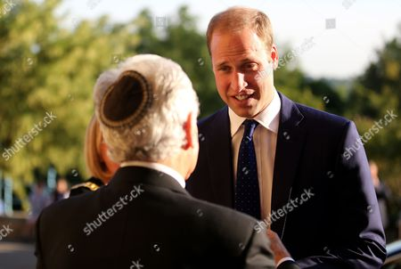 Prince William is greeted by Lord Levy