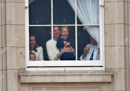 Prince George at the window of Buckingham Palace with nanny Maria Teresa Turrion Borrallo