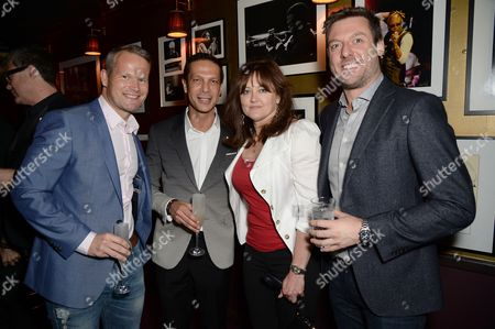 David Furnish and Anne Aslett with guests