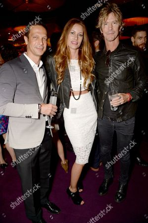 Stock Picture of Robert Tateossian with guest