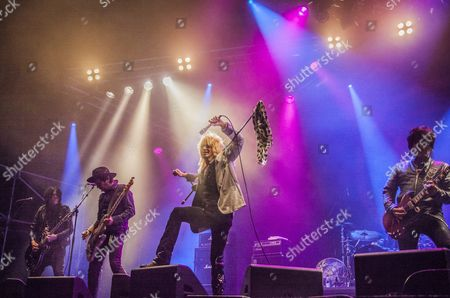 Michael Monroe band performing at Sweden Rock Festival 2015. Frontman Michael Monroe with guitarst Steve Conte and Sami Yaffa from New York Dolls