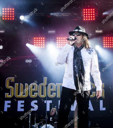 Dokken performing at Sweden Rock Festival 2015. Vocalist Don Dokken and drummer Mick Brown with the Sweden Rock Festival backdrop in the background