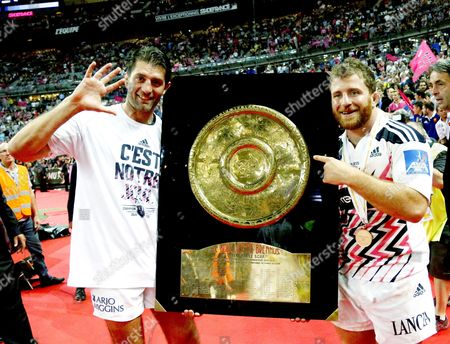 """French flanker Pierre Rabadan and French scrum half Jerome Fillol of Stade Francais hold the """"Bouclier de Brennus"""" as they celebrate after winning the French Top 14 final rugby Union match"""