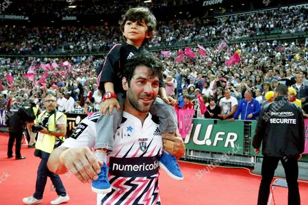 French scrum half Jerome Fillol of Stade Francais celebrates with his son after winning the French Top 14 final rugby Union match