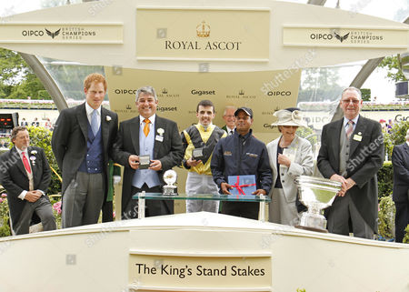 Presentation by Prince Harry to Mr J Sargeant and Mrs J Morley, Martin Harley and Robert Cowell for The King's Stand Stakes won by GOLDREAM Royal Ascot
