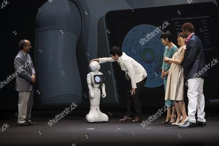 Stock Photo of Masayoshi Son chairman & CEO of SoftBank, robot Pepper, actor Koji Imada, actress Kanako Higuchi, announcer Kyoko Uchida and the actor Dante Carver