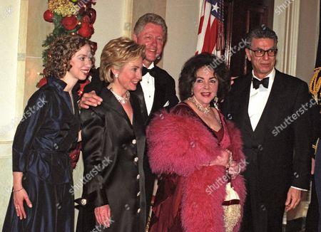 Stock Photo of Chelsea Clinton, Hillary Rodham Clinton, President Bill Clinton, Elizabeth Taylor, and Firooz Zahedi at the White House Millennium dinner