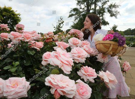 Staff member Emma Pike in the rose garden