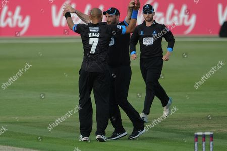 Michael Yardy and Tymal Mills Celebrate the wicket of Micael Carberry during the NatWest T20 Blast South Group match between Hampshire County Cricket Club and Sussex County Cricket Club at The Ageas Bowl, Southampton
