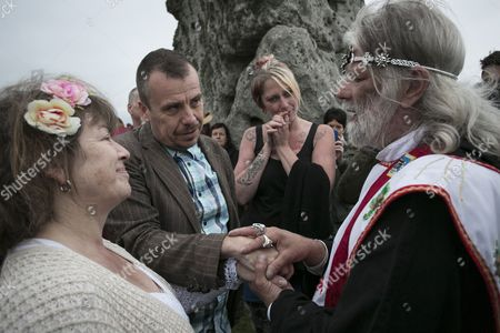Stock Picture of Druid leader Arthur Uther Pendragon marry a couple as the sun rises.