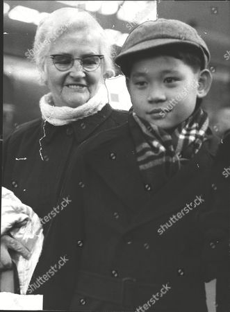 Salvation Army Major Catherine Smith With Ten-year-old Chew Ah-tsai Known As Jackie. Five Years Ago Miss Smith Broke Salvation Army Rules To Bring Him Back To Britain From An Orphanage She Started In Malaya. Box 0581 120615 00146a.jpg.