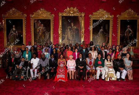 Queen Elizabeth II joins Young Leaders from across the Commonwealth at Buckingham Palace. (back row left to right) Alain Nteff (Cameroon), Samuel Karuita (Kenya), Karuna Rana (Mauritius), Isaiah Owolabi (Nigeria), Nosipho Bele (South Africa), Given Edward (Tanzania), Brighton Kaoma (Zambia), Donnya Piggott (Barbados), Kellyn George (Dominica), JavonLiburd (Saint Kitts & Nevis), Khairunnisa Ash'ari (Brunei Darussalam), Nicola Byrom (United Kingdom), Zo'Jackson (UnitedKingdom), Tabitha Besley (New Zealand), Christina Houaisuta (Solomon Islands), (second row left to right) unidentified woman, Mallah Enow Tabot (Cameroon), Caren Nelima Odanga (Kenya), Tanyaradzwa Daringo (Namibia), NadiaHitimana (Rwanda), EmmaDicks (South Africa), Angela Benedicto Mnagoza (Tanzania), ReginaMtonga (Zambia), Denielle Neal (Belize), Leroy Phillips (Guyana), Kenville Horne (St.Vincent & The Grenadines),Ashwini Angadi (India), K Thejitha Saubhagya Edirisinghe (Sri Lanka), Edmund Page (United Kingdom), John Taka (Papua New Guinea), Willy Missack (Vanuatu), (third row left to right) Joannes Paulus Yimbesalu (Cameroon), Barkha Mossae (Mauritius), Nkechikwu Azinge (Nigeria), Jean D'Amour Mutoni (Rwanda), Patrice Madurai (South Africa), Diana Nakaweesa (Uganda), AliciaWallace (Bahamas), Melissa Kargiannakis (Canada), Jerome Cowans (Jamaica), Teocah Dove (Trinidad and Tobago),Akshay Jadhao (India), Kavindya Thennakoon (Sri Lanka), Kate Row (Australia), Erna Takazawa (Samoa), (front row left to right) Abdikadir Aden Hassan (Kenya),Mohammad Yaaseen Edoo (Mauritius), Kelvin Ogholi (Nigeria),Philip Cole (Sierra Leone), Deo Sekandi (Uganda),Nondumiso Hlophe (Swaziland), Queen Elizabeth II Aaron Joseph Pinto (Canada), Nicole Nation (Jamaica), Shamir Shehab (Bangladesh), Devika Malik (India), Salman Ahmad (Pakistan), Emily Smith (Australia)