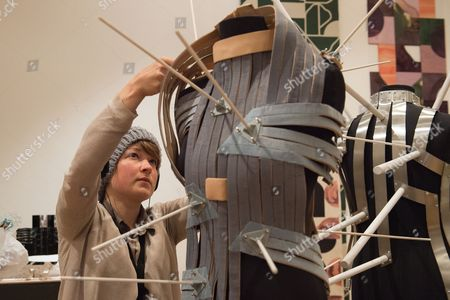 Sabine Roth makes the final adjustment to her design 'Sensable Space' which she co-developed with Cameron Bowen, Royal College of Art Graduate Exhibition 2015