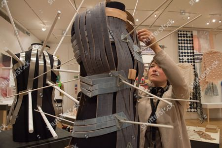 Stock Photo of Sabine Roth makes the final adjustment to her design 'Sensable Space' which she co-developed with Cameron Bowen, Royal College of Art Graduate Exhibition 2015