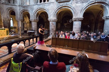 Stock Photo of Singaporean violinist, Siow Lee-Chin performs at concert at St Bartholomew the Great church as part of the City of London Festival.