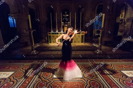 Stock Picture of Singaporean violinist, Siow Lee-Chin performs at concert at St Bartholomew the Great church as part of the City of London Festival.