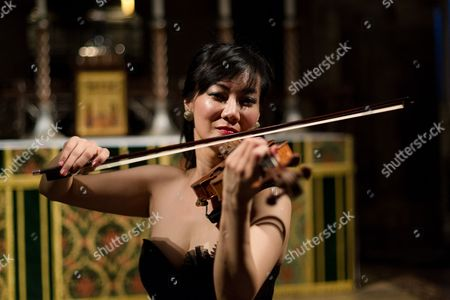 Singaporean violinist, Siow Lee-Chin performs at concert at St Bartholomew the Great church as part of the City of London Festival.