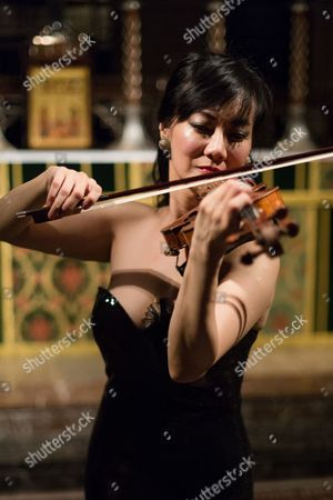 Stock Image of Singaporean violinist, Siow Lee-Chin performs at concert at St Bartholomew the Great church as part of the City of London Festival.