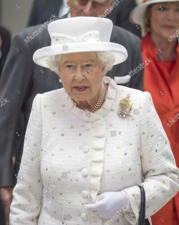 Stock Photo of Queen Elizabeth II and Prince Philip attended the 50th anniversary of the QueenÕs Lecture at Berlin's University of Technology, which was delivered by Neil MacGregor She later watched a concert and robots in action with Chancellor Angela Merkel and President Gauck