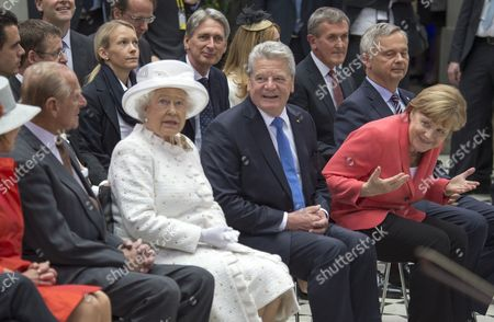 Stock Image of Queen Elizabeth II and Prince Philip attended the 50th anniversary of the Queens Lecture at Berlin's University of Technology, which was delivered by Neil MacGregor She later watched a concert and robots in action with Chancellor Angela Merkel and President Gauck
