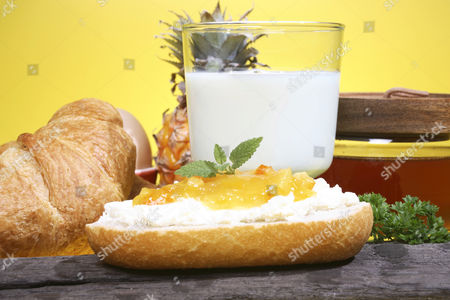 Breakfast containing cream cheese and a glass of milk