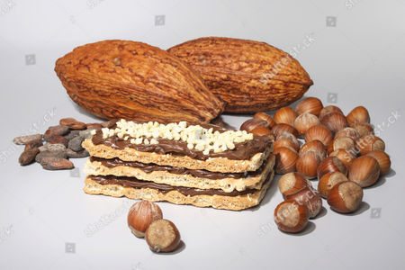 Nougat slice with cacao pods and hazelnuts