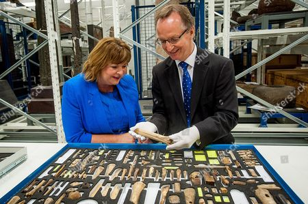 Fiona Hyslop and Museum Director, Gordon Rintoul, CBE, look at some viking artifacts from around 900AD, from Jarlshof, Shetland