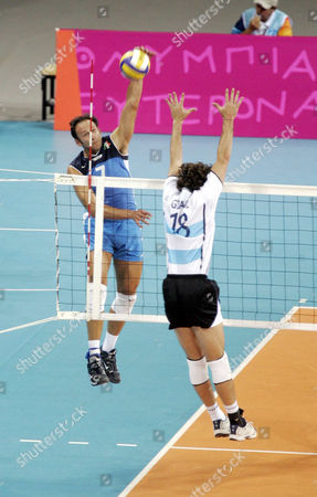 VOLLEYBALL: Italy Andrea Sartoretti smashes the ball past Argentina Gaston Giani (18) during their volleyball quarter final match