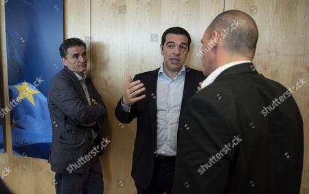 Greek Prime Minister Alexis Tsipras (C) with Efkleidis Tsakalotos (L) and Finance Minister Yianis Varoufakis (R)