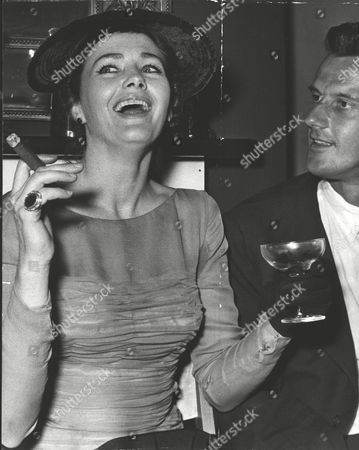 Editorial image of Vivienne Drummond Actress Smoking A Cigar And Drinking Champagne At The Wedding Reception Of John Osborne. Box 0586 150615 00149a.jpg.