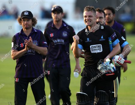 Stock Photo of Sussex's Luke Wright and Sussex's Michael Yardy celebrates hitting the winning runs