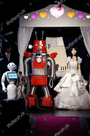 Stock Picture of Maywa Denki's Frois and Yuki Kashiwagi Android Yukirin join together in holy matrimony in Cay cafe in Omotesando