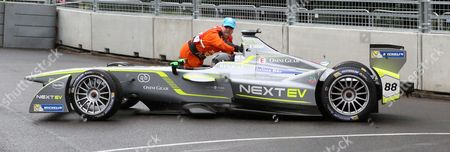 Oliver Turvey getting a push from a marshall after going off the track in qualification during the FIA Formula E Visa London ePrix at Battersea Park, London