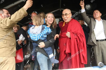 Dalai Lama on site with festival organiser Emily Eavis.